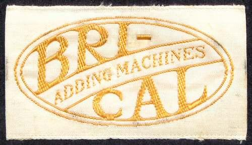 British Calculators Brical Embroidered Oval Logo From Case Lining Source: John Wolff