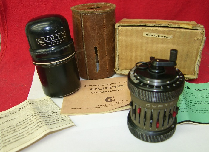 Curta Type II with Instructions, Container, Box and leather case (source ebay)